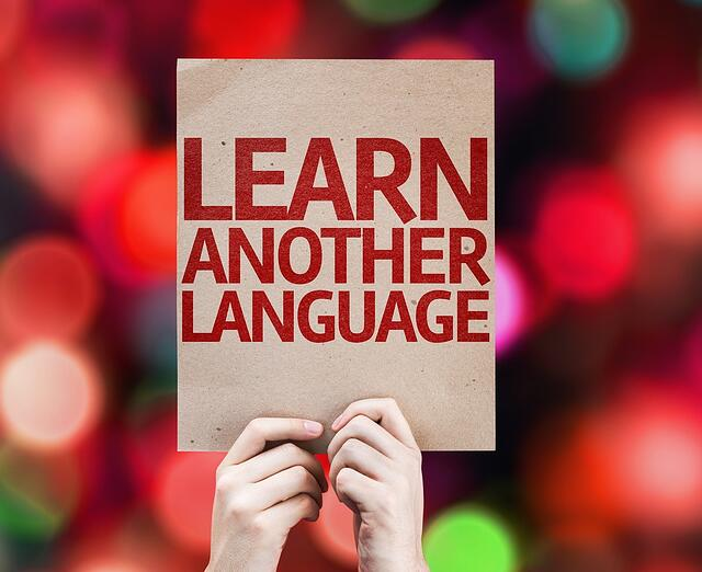 Learn Another Language card with colorful background with defocused lights.jpeg
